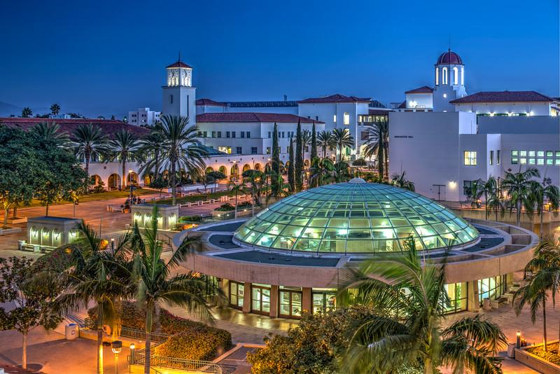 An aerial shot of the SDSU Library dome at night.
