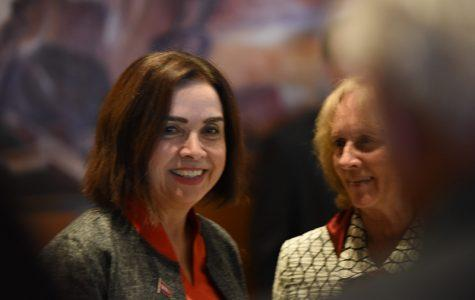 Photograph of incoming President Adela de la Torre and outgoing President Sally Roush taken at an event. Both are smiling. President de la Torre is looking into the camera.