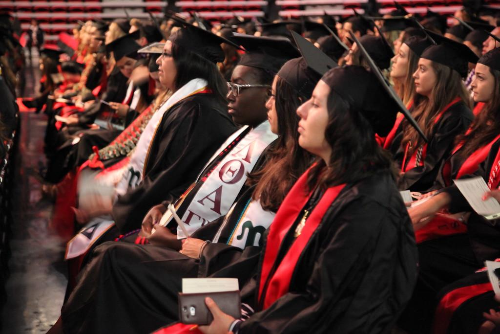 Photograph of students at a commencement ceremony.
